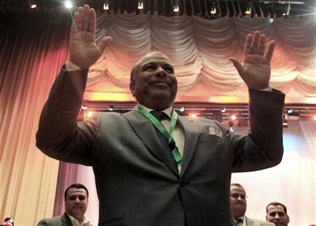 Saad al-Katatni (R) gestures to the crowd after he was chosen as the new chairman of the Muslim Brotherhood's Freedom and Justice Party (FJP) in Cairo, October 19, 2012. REUTERS/Mohamed Abd El Ghany