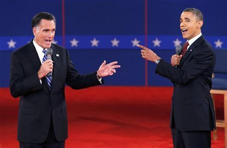 U.S. Republican presidential nominee Mitt Romney (L) and U.S. President Barack Obama speak directly to each other during the second U.S. presidential debate in Hempstead, New York, October 16, 2012. REUTERS/Mike Segar