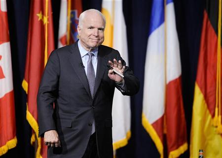 Senator John McCain takes the stage during the University of Southern California's Schwarzenegger Institute for State and Global Policy inaugural Symposium in Los Angeles, California, September 24, 2012. REUTERS/Gus Ruelas