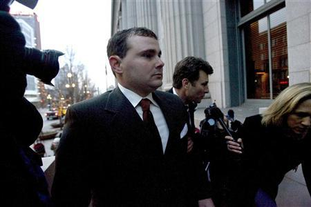 Former Blackwater Worldwide security guard Dustin Hard arrives with lawyer David Schertler at the U.S. District Court before surrendering to authorities in Salt Lake City, Utah, in this December 8, 2008 file photo. A federal judge threw out all charges on December 31, 2009 against five Blackwater Worldwide security guards accused of killing 14 Iraqi civilians in 2007, saying the U.S. government had recklessly violated the defendants' constitutional rights. Picture taken December 8, 2008. REUTERS/Chris Detrick/Files