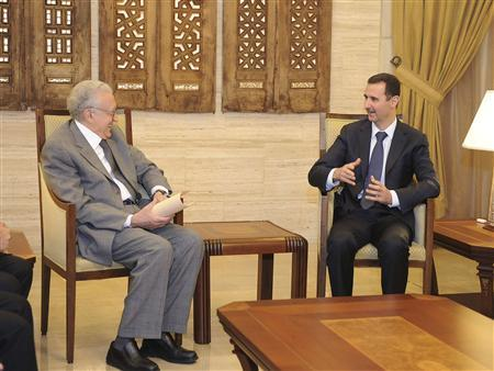 Syria's President Bashar al-Assad (R) meets U.N.-Arab League peace envoy for Syria Lakhdar Brahimi in Damascus October 21, 2012, in this handout photograph released by Syria's national news agency SANA. REUTERS/Sana