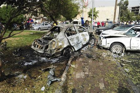 Damaged vehicles are seen after a car bomb exploded in the central Bab Touma district of Damascus October 21, 2012, in this handout photograph released by Syria's national news agency SANA.REUTERS/Sana