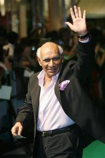 Bollywood director Yash Chopra arrives at the 9th International Indian Film Academy (IIFA) awards in Bangkok June 8, 2008. REUTERS/Chaiwat Subprasom/Files