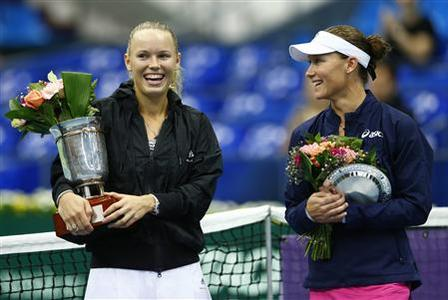 Denmark's Caroline Wozniacki holds her trophy after defeating Australia's Samantha Stosur (R) in the women's singles final at the Kremlin cup tennis tournament in Moscow October 21, 2012. REUTERS/Grigory Dukor