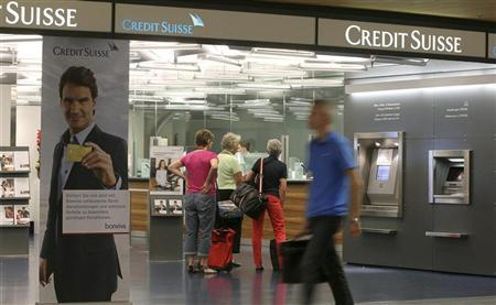 Customers stand at a branch office of Swiss bank Credit Suisse at the airport in Zurich August 2, 2012. REUTERS/Arnd Wiegmann