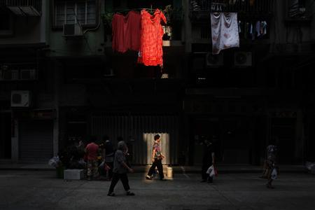 People walk on a street in a residential district in Macau October 11, 2012. REUTERS/Bobby Yip
