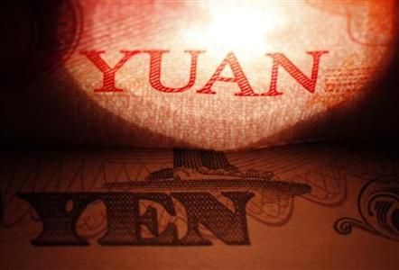 The words ''Yuan'' and ''Yen'' are seen on on Chinese and Japanese banknotes in this picture illustration taken in Tokyo in this May 29, 2012 file photo. REUTERS/Issei Kato/Files