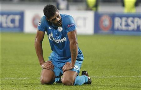 Zenit St. Petersburg's Hulk (L) reacts during his Champion's league Group C soccer match against AC Milan in St. Petersburg's Petrovsky Stadium October 3, 2012. REUTERS/Alexander Demianchuk