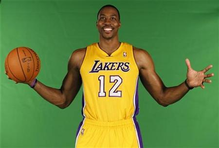 New center Dwight Howard poses for photos during NBA media day for the Los Angeles Lakers basketball team in Los Angeles October 1, 2012. REUTERS/Lucy Nicholson