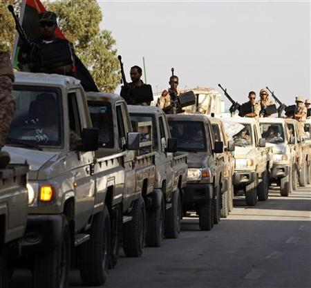 Members of the Libyan army force move towards the city of Bani Walid from, their headquarters in Tripoli October 18, 2012. REUTERS/Ismail Zitouny