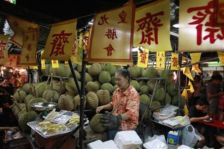 A durian fruit vendor sells her wares in Chinatown during the Vegetarian Festival in Bangkok October 20, 2012. REUTERS/Sukree Sukplang