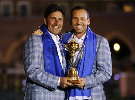Team Europe golfer Sergio Garcia (R) of Spain holds the Ryder Cup with captain Jose Maria Olazabal after the closing ceremony of the 39th Ryder Cup at the Medinah Country Club in Medinah, Illinois, September 30, 2012.'' REUTERS/Mike Blake