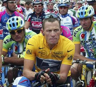 Then US Postal team rider Lance Armstrong of the U.S. waits in front of the pack of riders for the start of the 192.5km first stage of the 89th Tour de France cycling race in Luxembourg in this July 7, 2002 file photo. Armstrong has been stripped of his seven Tour de France titles and banned for life after the International Cycling Union (UCI) said on October 22, 2012 it had ratified the United States Anti-Doping Agency's (USADA) sanctions. REUTERS-Eric Gaillard-Files