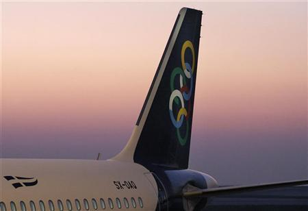 An Olympic Air aircraft is seen before the first official flight of the new carrier in Athens International airport October 1, 2009. REUTERS/Yiorgos Karahalis
