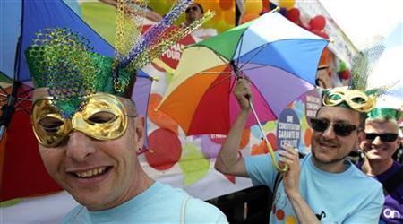 People take part in the annual Gay Pride march in Paris, June 30, 2012. REUTERS/Mal Langsdon