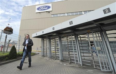 A worker leaves the Ford assembly plant in Genk October 22, 2012. Ford called an emergency meeting with unions at its assembly plant in Genk, Belgium, amid mounting expectations that the U.S. automaker is preparing to close the factory. Ford summoned staff representatives to a meeting with European executives at 0700 GMT on Wednesday without providing an agenda, officials from three unions said on Monday. REUTERS/Laurent Dubrule