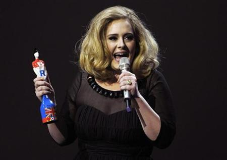 Adele speaks as she holds her award for best British female solo artist during the BRIT Music Awards at the O2 Arena in London February 21, 2012. REUTERS/Dylan Martinez