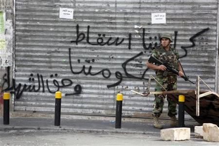A Lebanese army soldier holds his gun while securing an area, where clashes between the army and Sunni Muslim gunmen took place, in Beirut October 22, 2012. REUTERS/Mohamed Azakir