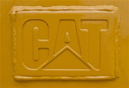 A welded steel CAT logo is seen on a Caterpillar tractor scraper at Holt Caterpillar, the largest Caterpillar dealer in the United States, in San Antonio, Texas March 19, 2012. REUTERS/Richard Carson
