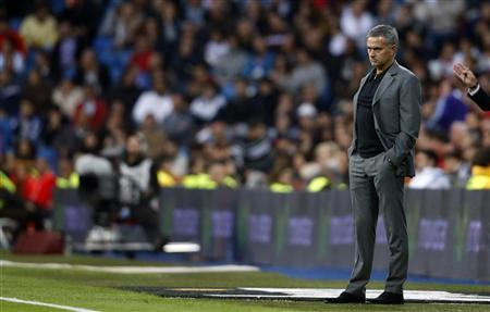 Real Madrid's coach Jose Mourinho watches their Spanish First Division soccer match against Celta Vigo at Santiago Bernabeu stadium in Madrid October 20, 2012. REUTERS/Susana Vera