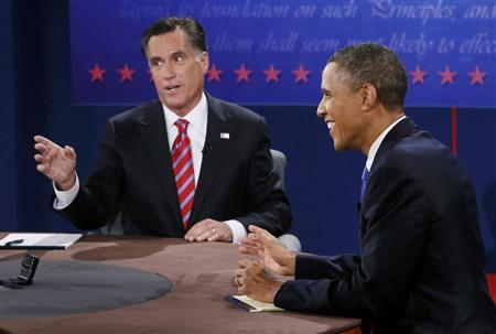 U.S. President Barack Obama (R) laughs as Republican presidential nominee Mitt Romney speaks during the final U.S. presidential debate in Boca Raton, Florida October 22, 2012. REUTERS/Rick Wilking