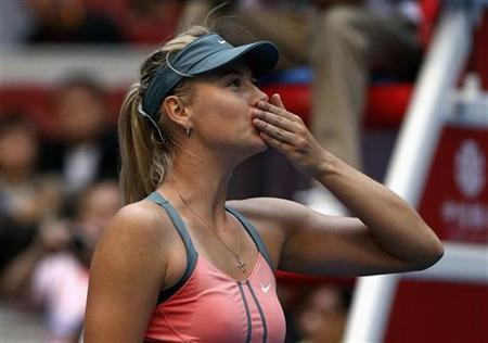 Russia's Maria Sharapova blows a kiss to the crowd after winning her second round women's singles match against Romania's Sorana Cirstea at the China Open tennis tournament in Beijing October 3, 2012. REUTERS/David Gray