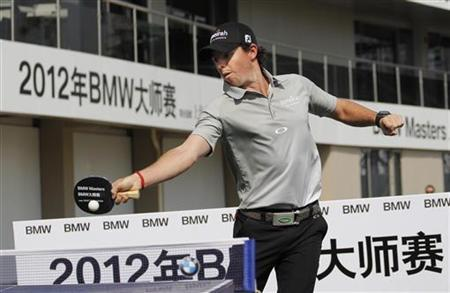 Rory McIlroy of Northern Ireland plays table tennis (ping pong) during a promotional presentation event at the BMW Masters 2012 golf tournament in Shanghai October 23, 2012. REUTERS/Carlos Barria