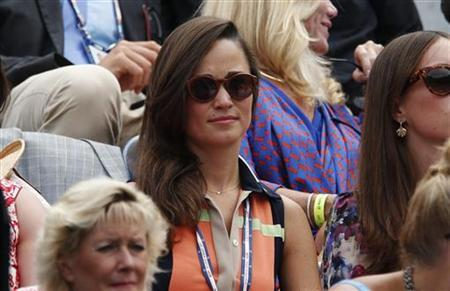 Pippa Middleton, the sister of Catherine, Duchess of Cambridge, watches from the gallery at the U.S. Open tennis tournament in New York September 4, 2012. REUTERS/Eduardo Munoz