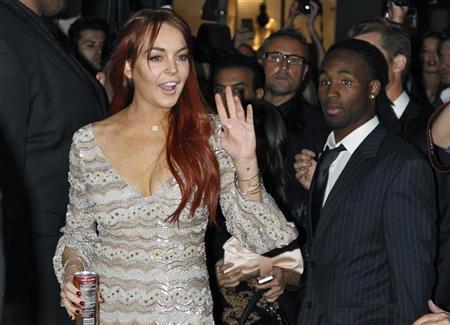 Actress Lindsay Lohan waves as she arrives for the Mr. Pink Ginseng Drink launch party at the Beverly Wilshire Hotel in Beverly Hills, California, October 11, 2012. REUTERS/Jonathan Alcorn
