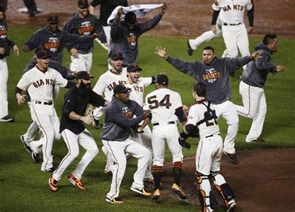 The San Francisco Giants celebrate after defeating the St. Louis Cardinals to advance to the World Series after Game 7 in their MLB NLCS playoff baseball series in San Francisco, October 22, 2012. REUTERS/Stephen Lam