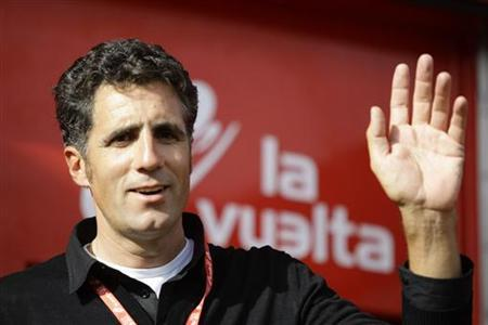 Five-time Tour de France winner Miguel Indurain of Spain waves after the 17th stage of the Tour of Spain ''La Vuelta'' cycling race in Penafiel, September 15, 2010. REUTERS/Miguel Vidal