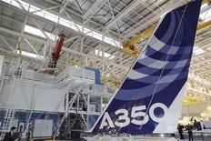 The vertical tail wing of the first Airbus A350 is seen on the final assembly line in Toulouse, southwestern France, October 23, 2012.The A350 is Europe's first contribution to a new generation of jets designed to cut airline fuel bills by using mainly lightweight carbon-composite materials. Airbus inaugurated the factory with aims to compete for the demand of more than 6,000 mid-sized, long-range jets over the next 20 years, a market worth several hundreds of billions of dollars. Airbus says the A350 will take to the skies in the summer of 2013 for testing and enter service in the second half of 2014. REUTERS/Jean-Philippe Arles