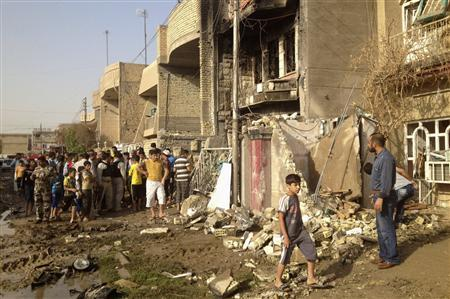 Residents inspect a destroyed building at the site of a bomb attack in Chukook district, in Baghdad October 23, 2012. REUTERS/Saad Shalash