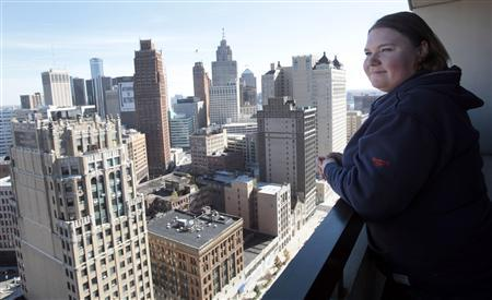 Jeanette Pierce stands on an outside balcony in the high-rise apartment building she lives in downtown Detroit, Michigan on October 16, 2012. REUTERS-Rebecca Cook