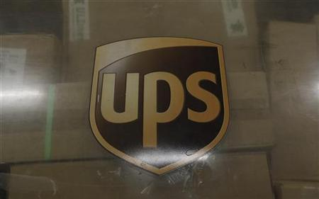 The emblem of of United Parcel Service (UPS) is seen at the cargo center at the Cologne/Bonn airport near Cologne November 1, 2010. REUTERS/Ina Fassbender