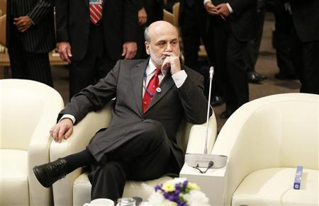 U.S. Federal Reserve Chairman Ben Bernanke is seen prior to the International Monetary and Financial Committee at the annual meetings of the IMF and the World Bank Group in Tokyo October 13, 2012. REUTERS/Kim Kyung-Hoon