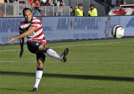 Landon Donovan of the U.S. makes a pass during the first half of their international friendly soccer match against Canada in Toronto June 3, 2012. REUTERS/ Mike Cassese/Files