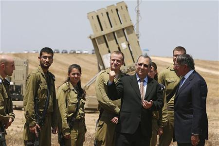 Israeli Defense Minister Ehud Barak (C) and U.S. Defense Secretary Leon Panetta (R) greet Israeli soldiers after a joint news conference while they visit the Iron Dome defense system launch site in Ashkelon August 1, 2012. REUTERS/Mark Wilson/Pool