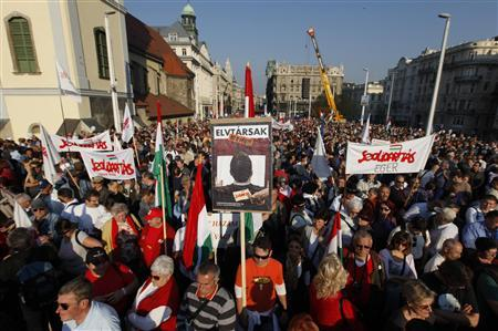Tens of thousands of Hungarians protest against Prime Minister Viktor Orban's government during the 56th anniversary of Hungary's 1956 revolution against Soviet rule, in central Budapest October 23, 2012. REUTERS/Laszlo Balogh