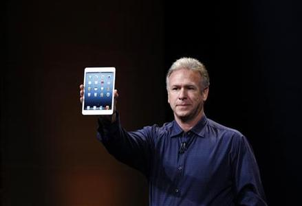 Apple senior vice president of worldwide marketing Philip Schiller introduces the new iPad mini during an Apple event in San Jose, California October 23, 2012. REUTERS/Robert Galbraith