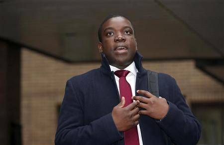 Former UBS trader Kweku Adoboli arrives at Southwark Crown Court in central London October 22, 2012. REUTERS/Suzanne Plunkett