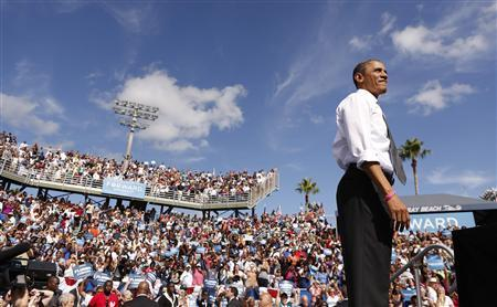 U.S. President Barack Obama looks out at the crowd at a campaign rally in Delray, Florida October 23, 2012. REUTERS/Kevin Lamarque