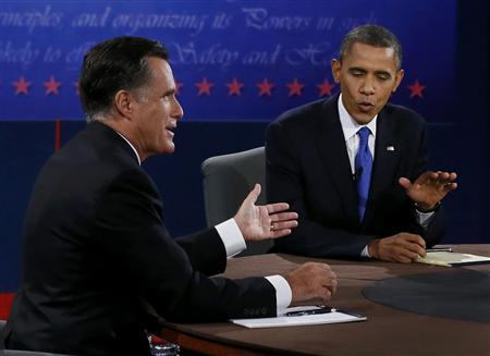 U.S. President Barack Obama (R) and Republican presidential nominee Mitt Romney talk during the final U.S. presidential debate in Boca Raton, Florida October 22, 2012. REUTERS/Rick Wilking