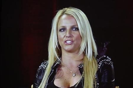 Singer Britney Spears, a judge from the reality series ''The X Factor'', is pictured on a video screen via satellite from Miami, Florida, during a panel discussion at the Fox television network portion of the Television Critics Association Summer press tour in Beverly Hills, California July 23, 2012. REUTERS/Fred Prouser/Files