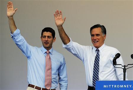 Republican presidential nominee Mitt Romney (R) and vice-presidential nominee Paul Ryan wave at the conclusion of a campaign rally in Henderson, Nevada October 23, 2012 REUTERS/Brian Snyder