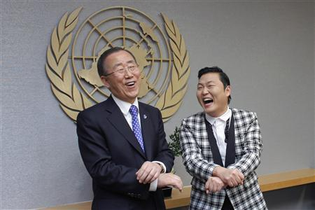 South Korean singer Psy (R) practises some ''Gangnam Style'' dance steps with U.N. Secretary-General Ban Ki-moon during a photo opportunity at the U.N. headquarters in New York October 23, 2012. REUTERS/Eduardo Munoz