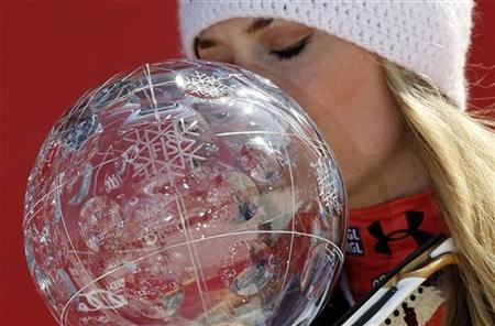Lindsey Vonn from the U.S. kisses her trophy after winning the women's overall World Cup at the Alpine skiing World Cup finals in Schladming March 18, 2012. REUTERS/Leonhard Foeger