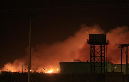 Fire engulf the Yarmouk ammunition factory in Khartoum October 24, 2012. REUTERS/Stringer