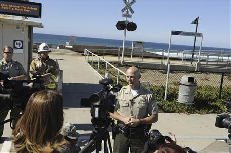 Lt. Erik Raney, Santa Barbara County Sheriff's spokesperson, answers questions during a media briefing following a shark attack in the waters off of Vandenberg's Surf Beach, near Vandenberg Air Force Base, Califoria in this handout photograph released by the U.S. Air Force on October 23, 2012. REUTERS/SSgt Levi Riendeau/U.S. Air Force Photo/Handout