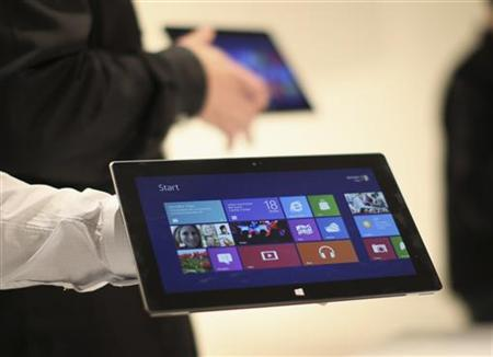 Microsoft representatives hold a new Surface tablet computer as it is unveiled by Microsoft in Los Angeles, California, June 18, 2012. REUTERS/David McNew/Files